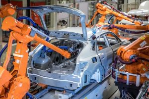 At_its_paint_shop_in_Győr,_Hungary,_Audi_is_testing_a_new_method_of_body_sealing._Before_a_car_is_given_its_paint_finish,_a_paste-like_sealing_material_is_applied_to_areas_such_as_the_weld_seams._This_improves_vehicle_acoustics,_guards_against_corrosion_a