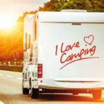 Camping_Lover_in_the_Camper_Van_on_the_Route_to_Summer_Vacation_Destination.